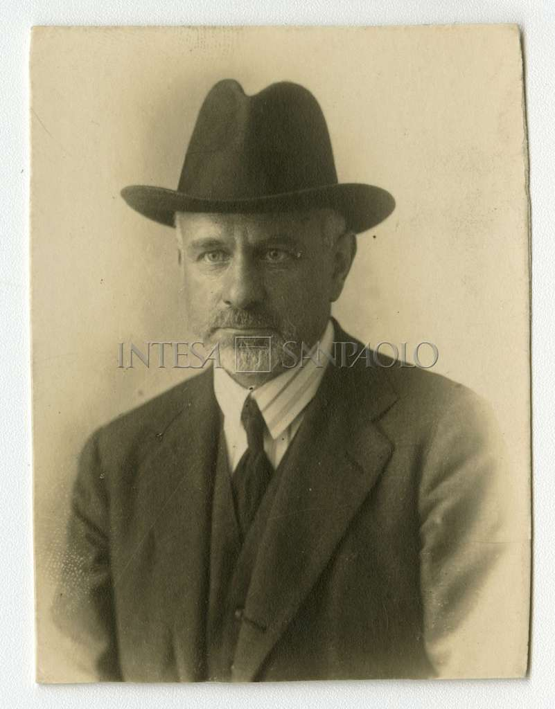 Studio portrait of Bernardino Nogara wearing a hat and tie, ca. 1920-1930 (photographer unknown)